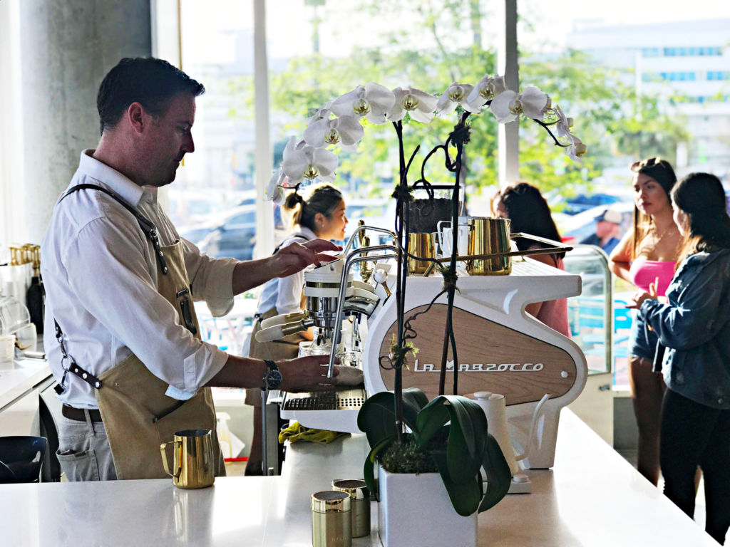 Barista making coffee on lincoln road